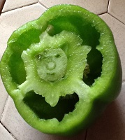 A smiley green pepper
